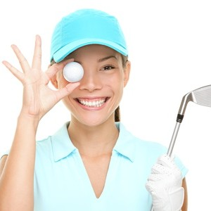 women in golf eyeing golf ball