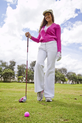 woman in pink playing golf
